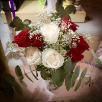 White and Red Roses Arrangement in Clear Glass Vase
